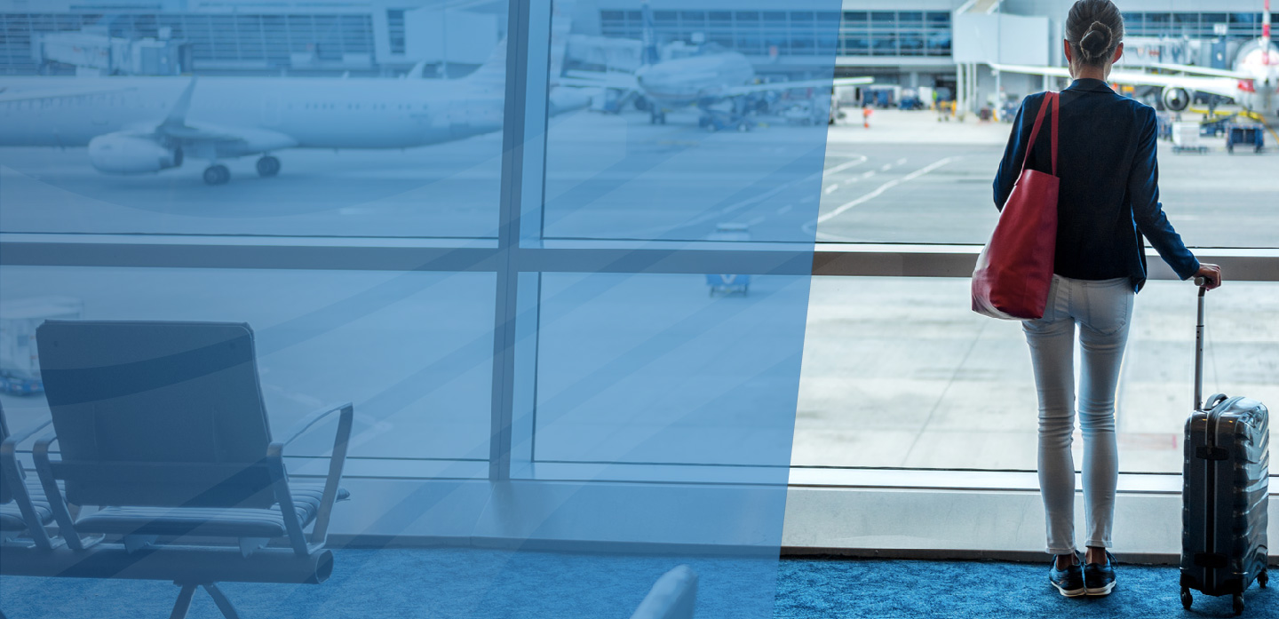 Woman looking out the window of the airport